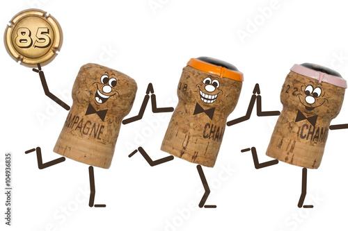 Poster 85 Jubiläum - drei tanzende Champagnerkorken