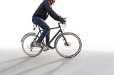 Man riding bike in blurred motion on white - 104956091