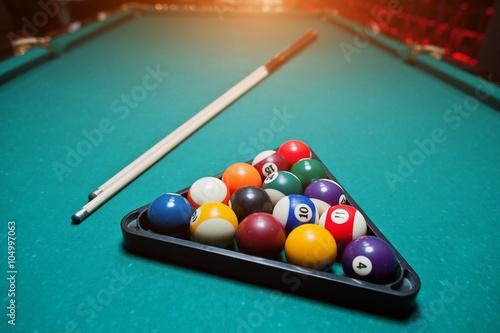Staande foto Billiard balls in a pool table at triangle with billiard cue