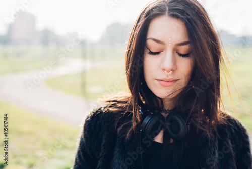 Half length of young beautiful caucasian  woman with headphones