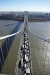 An aerial view of traffic crossing the George Washington bridge over the Hudson River