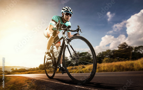 obraz PCV Asian men are cycling road bike in the morning