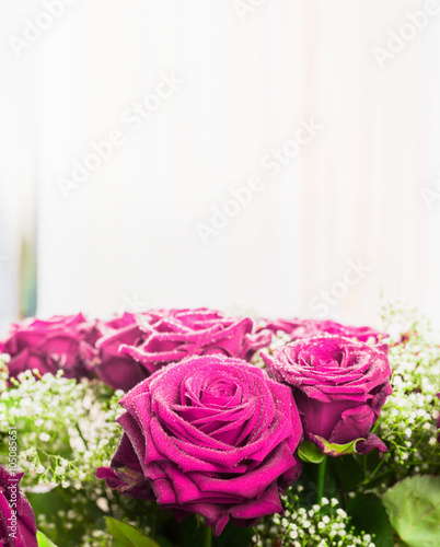 Pink roses bunch on light background, close up. Festive roses bouquet