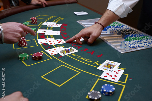A close up of a blackjack dealer's hands in a casino, very shallow depth of fiel Poster