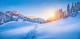 Fototapety Winter wonderland in the Alps with mountain chalet at sunset