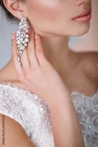 Beautiful bride with wedding makeup and hairstyle isolated in studio © armina