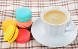 close up of colorful macarons and cup of coffee - 105153229