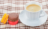 close up of colorful macarons and cup of coffee - 105153252