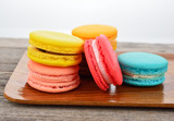 colorful macarons on wooden tray - 105153425