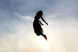 Silhouette of Woman Rising into Heaven