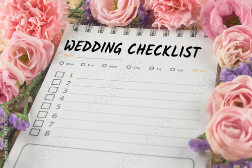 word wedding checklist note paper on pink flower background Poster