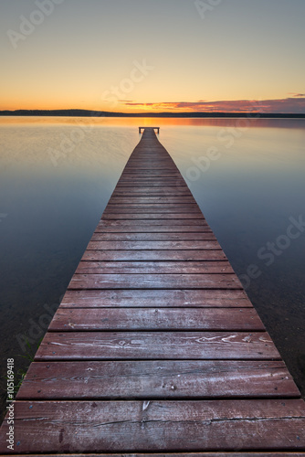 Naklejka Old wooden pier on sunset
