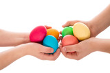 pile of easter eggs in two child hands