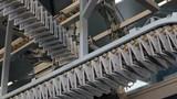 printing paper and newspaper, diagonal shot of conveyor belt transporting newspapers