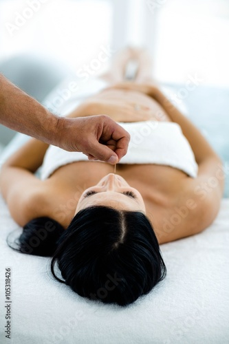 Pregnant woman receiving a spa treatment from masseur for Pregnancy and spa treatments