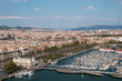 Panoramic view of Port Vell in Barcelona. Sagrada Familia and Torre Agbar are visible in the distance.
