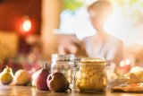 homemade rustic jar of fruits with pears on wooden table - blur