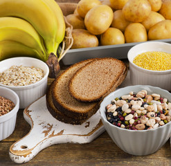 Foods high in carbohydrate on a wooden table.