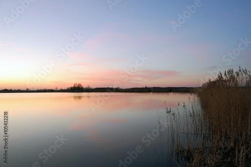 Panel Szklany Zachód słońca nad jeziorem