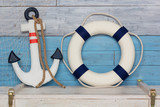 Anchor and life buoy on wood background blue-white - 105440229