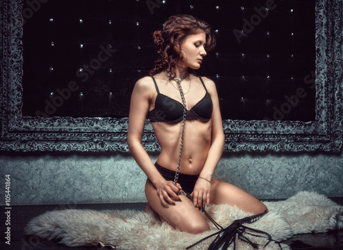 Sexy submissive brunette in black lingerie waiting for sentenceon Poster