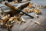 Woodworking tools with wooden background and shavings