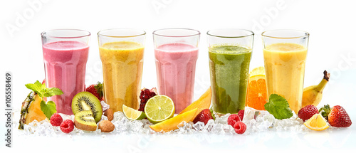 Long row of tropical fruit drinks in tall glasses - 105558469