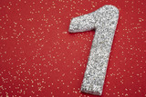 Number one silver color over a red background. Anniversary