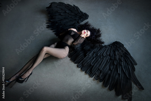 Fallen black angel with wings. Sexual woman Poster