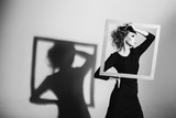 Сharismatic woman frame in his hands, fashion pose, black and white photo, studio shooting negativity, loneliness, divorce, pain, depression
