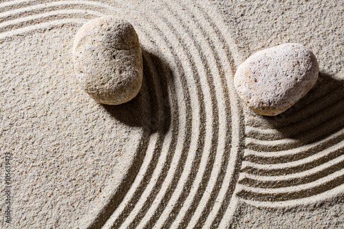 Foto op Plexiglas Stenen in het Zand zen sand still-life - two stones across lines to give different directions for concept of change or flexibility with peace, top view