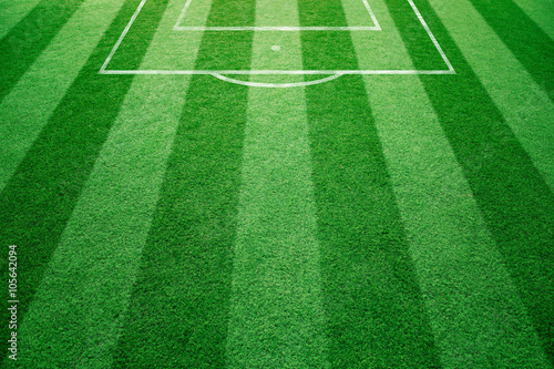 Conceptual football field with soccer goal lines background. Empty soccer field details on soccer field ground.