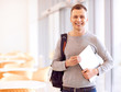 Pleasant student holding folder