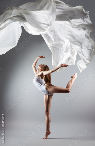 beautiful young girl dancing. Flowing fabric. Plakát