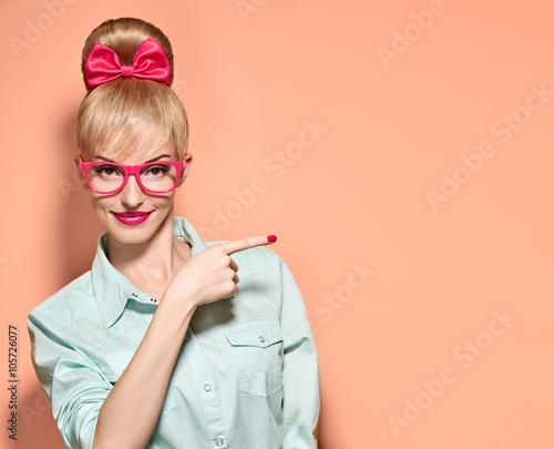 Hipster girl in stylish glasses shows finger