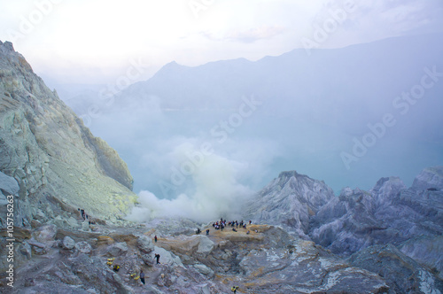 Poster Ijen volcano in East Java contains the world's largest acidic volcanic crater lake, called Kawah Ijen, spewing out sulphur smoke in the morning