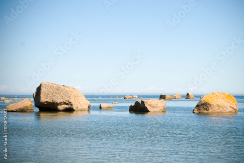 Poster boulders, stones in the sea / water