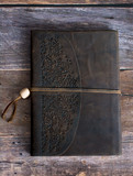 Classic Leather Bound Journal Book on a Old Barn Board Floor Straight On