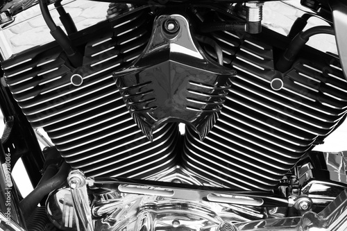 Poster Motorbike's chromed engine black and white background