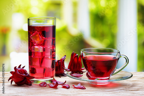 Cup of hot hibiscus tea (red sorrel) and the same cold drink