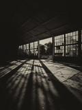 Silhouette of abandoned factory building on sunny day