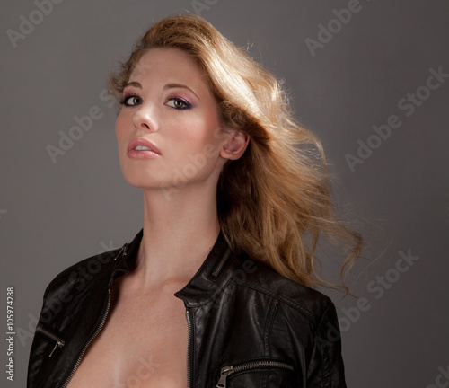 Beautiful Young Woman in Leather Jacket With Blowing Hair © mpaphotoftl