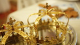 Close up of two gold wedding crowns prepared for ceremony  of marriage in a  church.