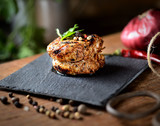 roasted fillet medallion on a wooden background
