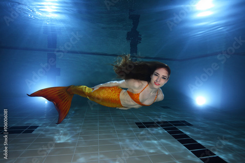 Poster Mermaid swimming underwater in the pool