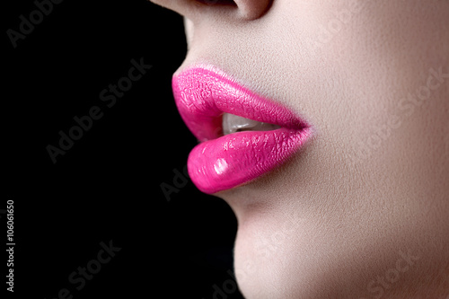 Juliste Closeup macro photo of pretty natural lips with pink glossy lipstick on black background
