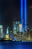 NEW YORK CITY - SEPTEMBER 11: The Statue of Liberty as seen in the evening of September 11, 2015 in New York City.  The 9-11 memorial lights can be seen in the background. - 106078014