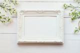 Vintage frame on white wooden background