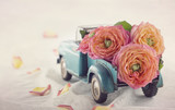 Old antique toy truck carrying a roses