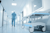 Walking doctor in hospital department.